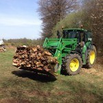 tractor carrying wood pic